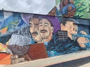 Murals of people drinking, reading and playing music